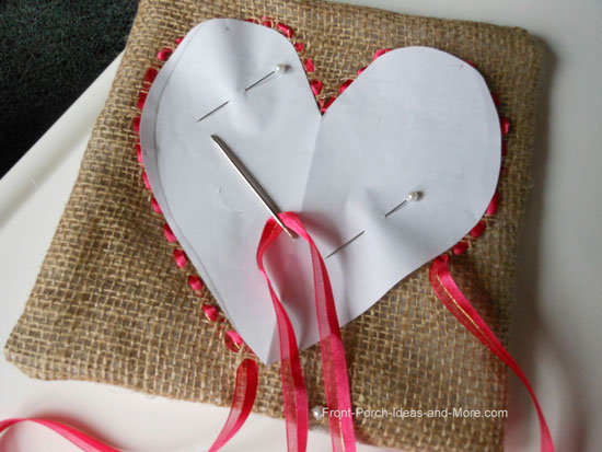 I wove red ribbon onto the burlap with a large-eyed needle following the paper heart template