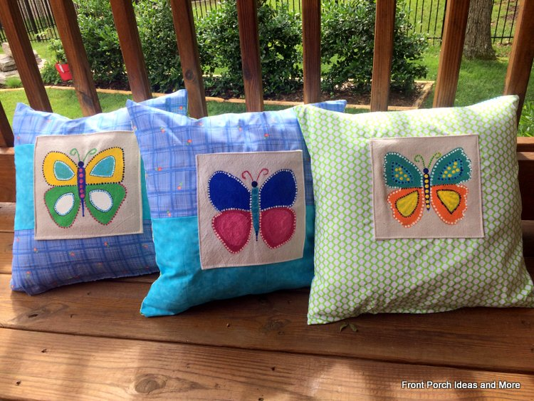 three butterfly pillows