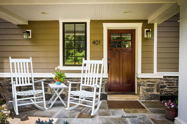 A pair of white country rocking chairs on front porch