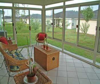 Sun room designs joy studio design gallery best design for Sunroom flooring ideas