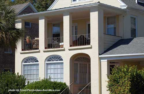double porches with wrought iron balustrade