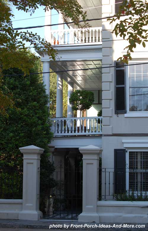 side porch with wrought iron entrance