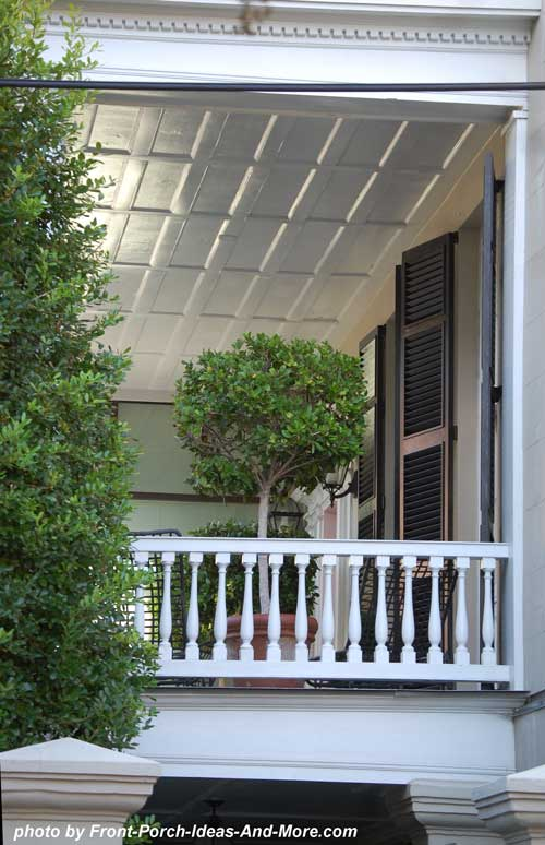 side porch with coffered ceiling and hanging basket