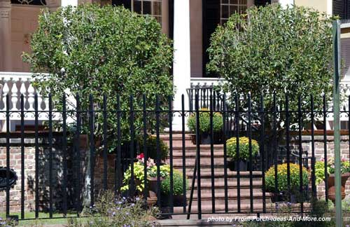 wrought iron fence in front of porch
