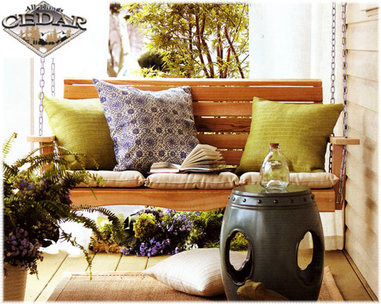 summer on our porch with bright pillow toppers