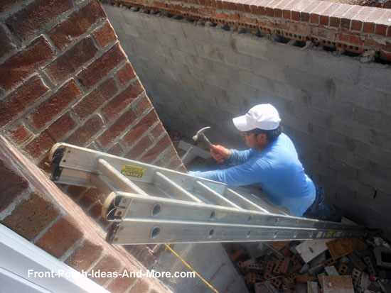 individual chipping holes in brick to accommodate steel support channels