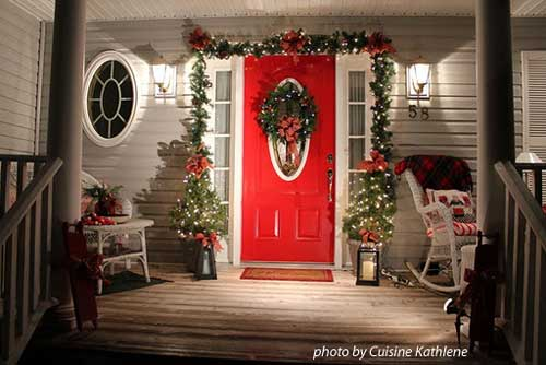 front door wreath surrounded by garland