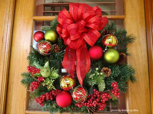 colorful red bow on front door wreath