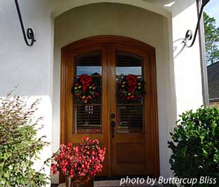 French doors with Christmas wreaths