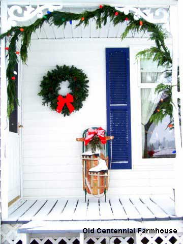 Outdoor Christmas decorations - love the sled on Joni's porch