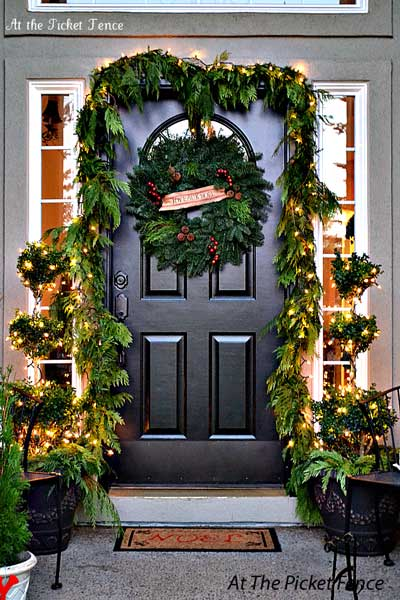 Evergreen Christmas garland door decoration & A Christmas Door Decoration for Holiday Spirit!