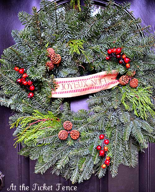 Holiday wreath with pine cones and berries