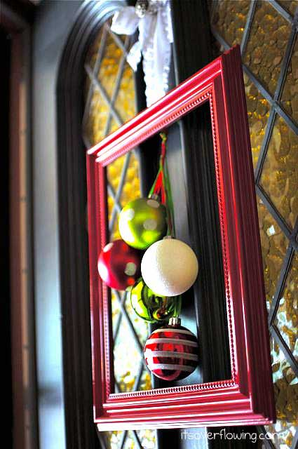 Holiday frame with Christmas ornaments on Front Door
