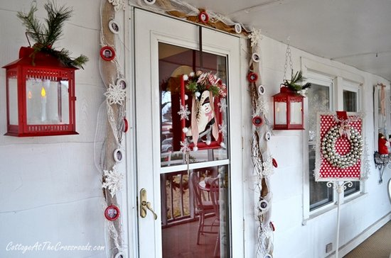 Outside Christmas decor by Cottage at the Crossroads - red lanterns at front door
