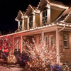 house and yard decorated with outdoor Christmas lights