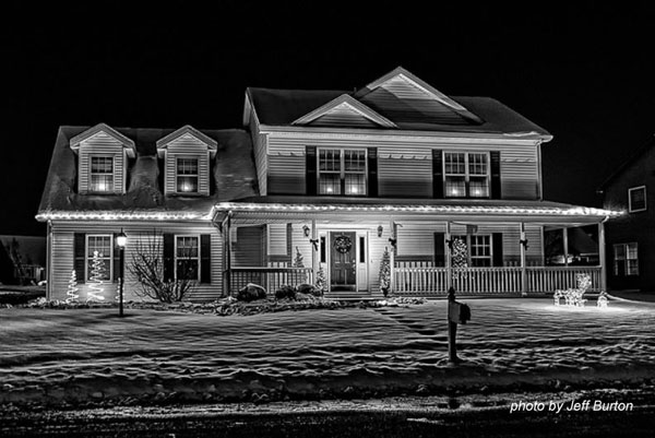 black and white photo of christmas lights on home