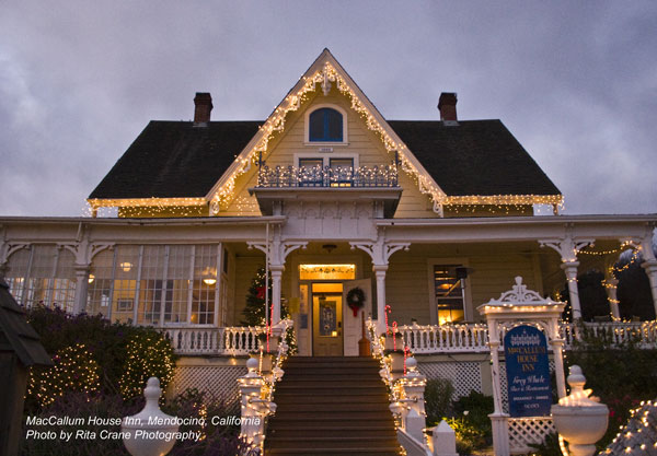 Christmas lights on MacCallum House Inn & Restaurant gable and handrails; photo by Rita Crane Photography