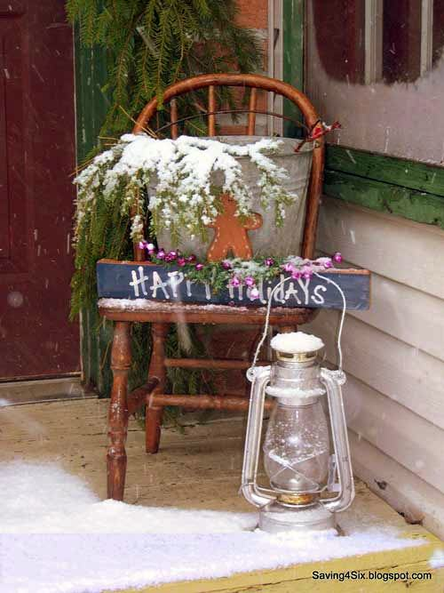 old kitchen chair on front porch decorated for Christmas