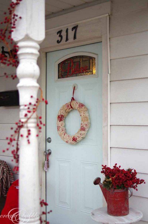 Create and Babble - berry garland wrapped around porch columns