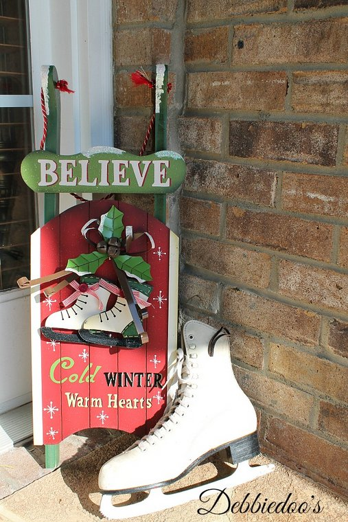 delightful Christmas decor - Debbie Doo's - vintage sled and ice skate in corner of porch