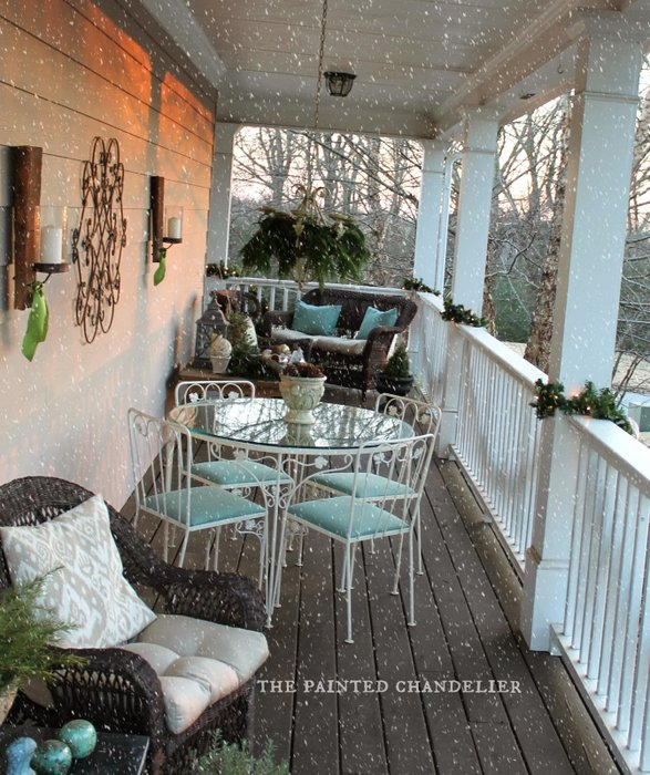 The Painted Chandelier - decorated with dining set, soft green cushions, wicker furniture and beautiful amenities