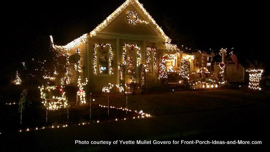 Christmas lights brighten the front porch and yard