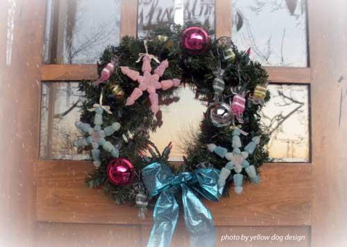 snowflake wreath on front door