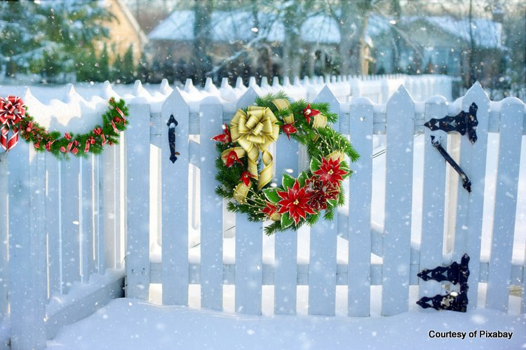 White picket fence with Christmas wreath