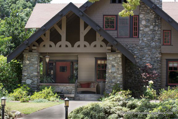 classic craftsman porch with tapered stone pedestals