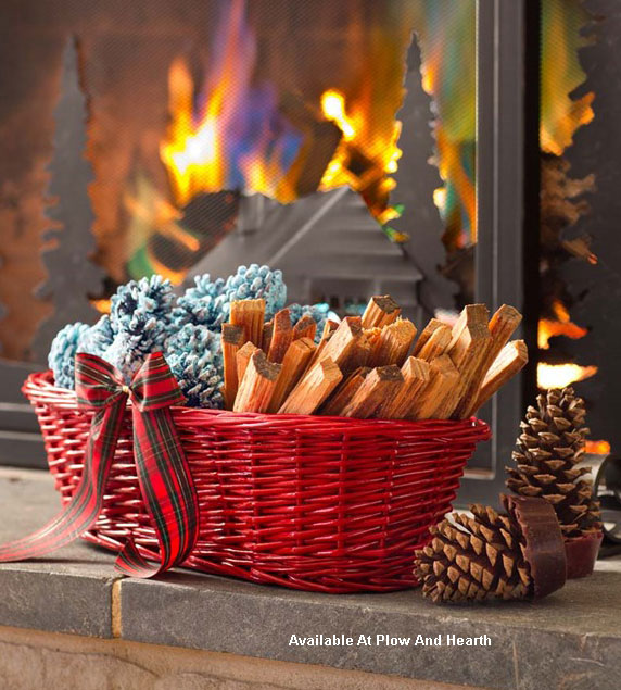 basket with color pine cones and firestarter in front of fireplace