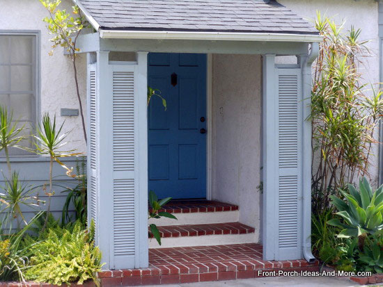 shutters installed between aluminum porch columns on front porch