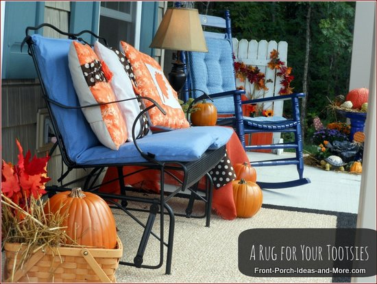 autumn porch with area rug, cushions and pillows