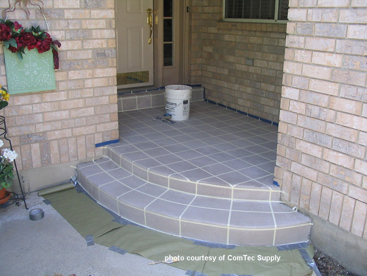 Awesome concrete front porch and steps in process of staining