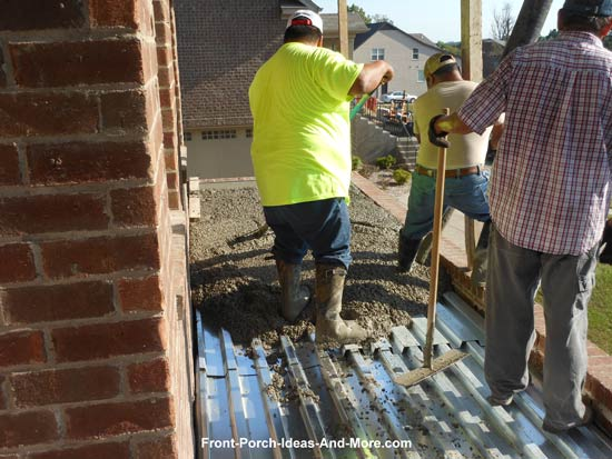 concrete being poured over steel sheathing