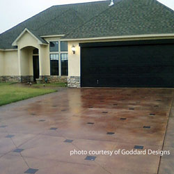 Perfect stained concrete driveway with inlays by goddard designs