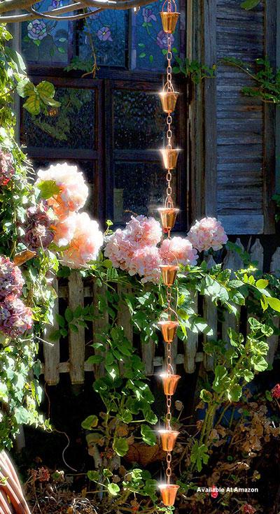 copper rain chain hanging in garden area