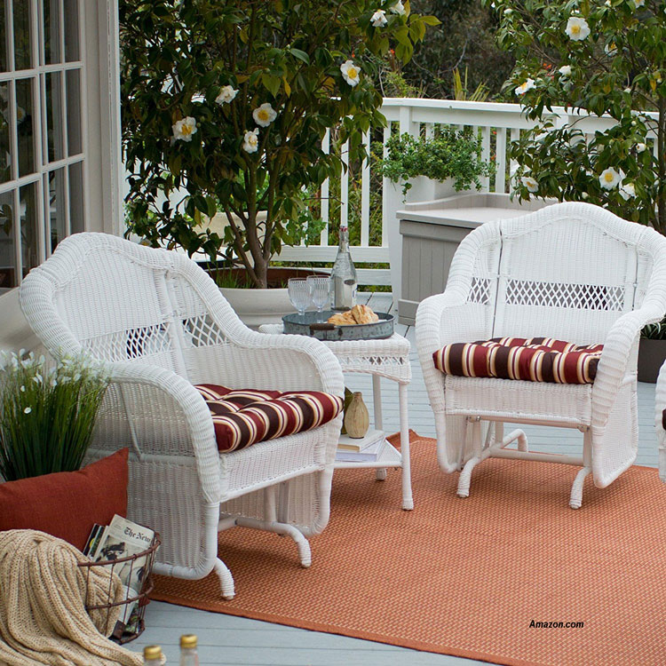 white wicker glider chairs on patio