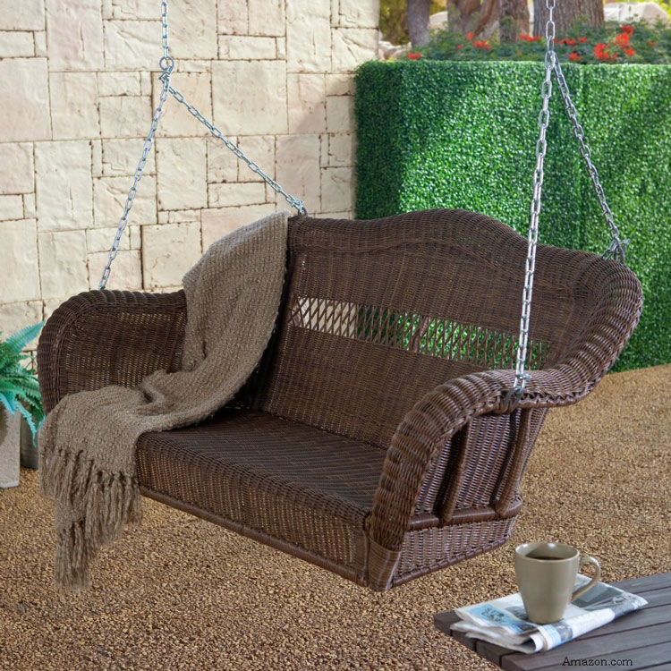 beautiful brown wicker porch swing on front porch