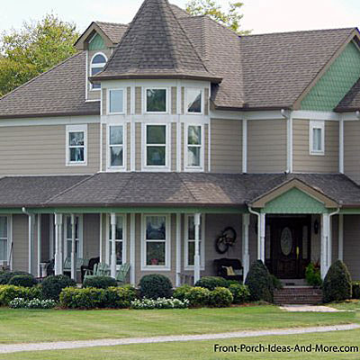 large contemporary wrap around country front porch
