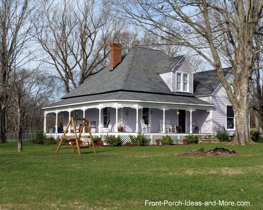 Farm house porches country porches wrap around porches for Modern homes with wrap around porches