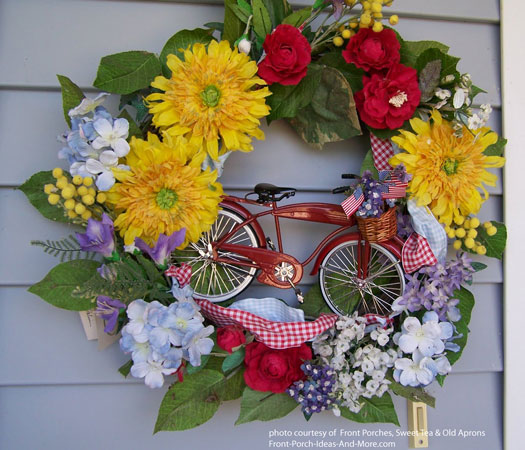 Decorative front door wreath for summer with retro red bike