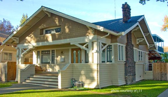 classic Craftmans front porch with triple porch columns on pedestals
