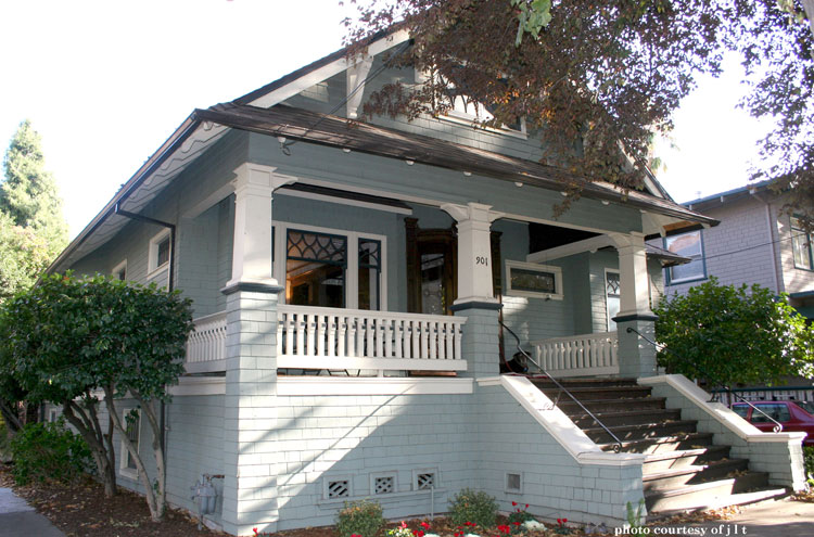 craftsman style home with wooden balustrade