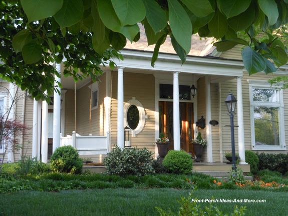 soothing and curb appealing front porch with swing
