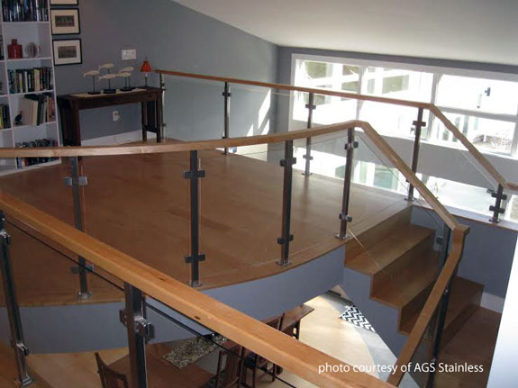 curved glass railings on interior of home