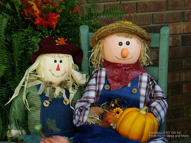 adorable scarecrow couple on front porch for fall