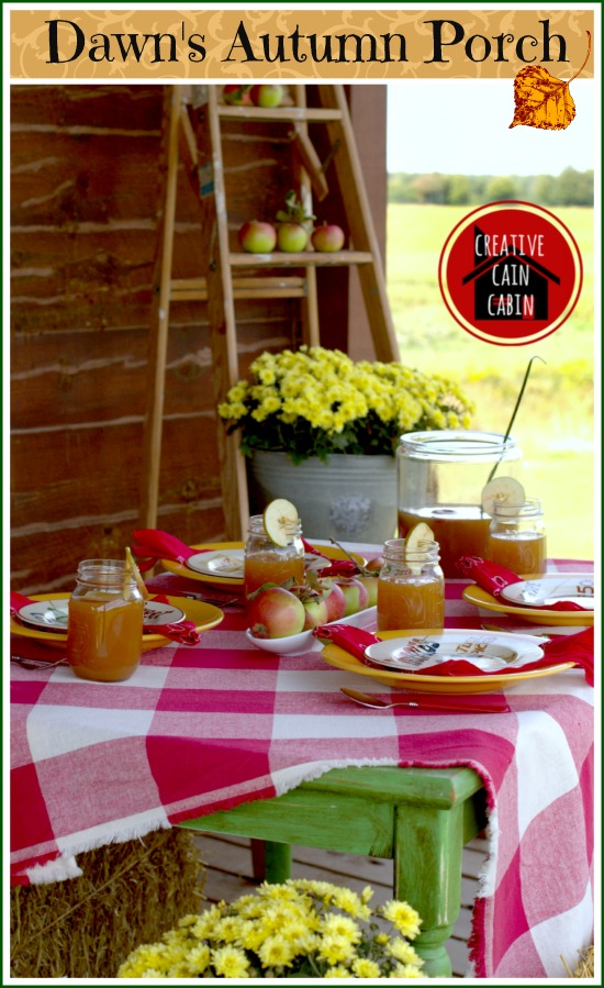 Dawn decorates her autumn porch with apples and gingham