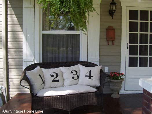 Wicker love seat with numbered docorative pillows