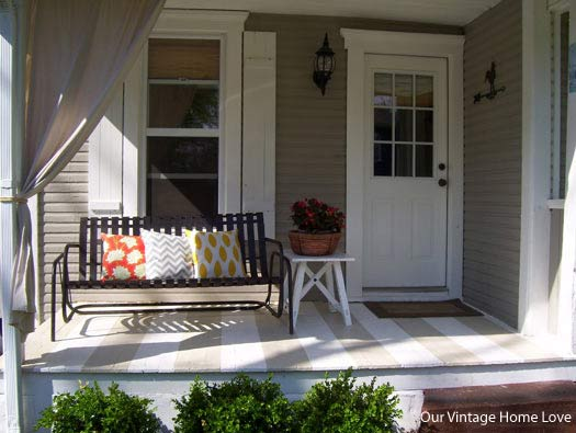 Decorated side-porch with glider