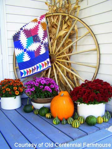 Decorating for fall with quilts, wagon wheel and stunning mums